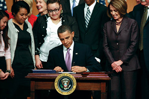 Barack Obama signs the Health Care and Education Reconciliation Act of 2010