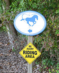 Sign: 'Be alert riding area'