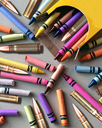 Crayons and rifle cartridges scattered on a table