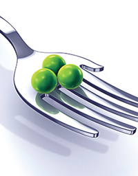 hand shaped fork holding 3 peas