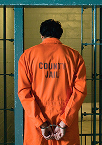 Back of white man in orange county jail jumpsuit