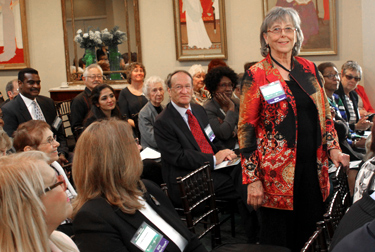 NASW member stands in audience at an event