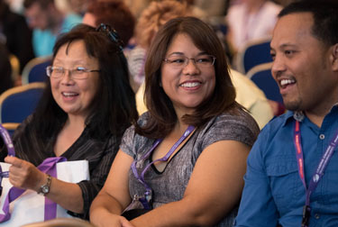 three women stand together at an NASW national conference