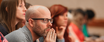 seated conference attendees listening intently