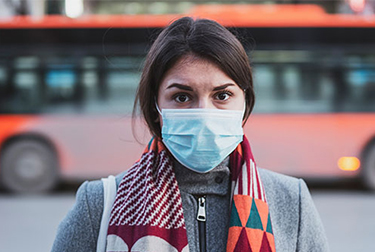 woman on the street with protective face mask
