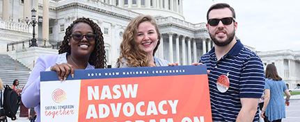 three people holding a sign that reads NASW Advocacy, with U.S. Capitol building in background