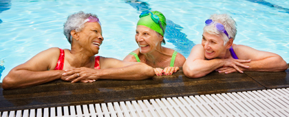 three older women in a swimming pool