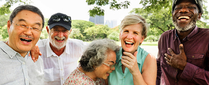 group of older adults of different races, laughing together