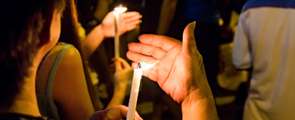 people holding candles at a peaceful protest