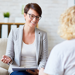 mid-career social workers speaks with client
