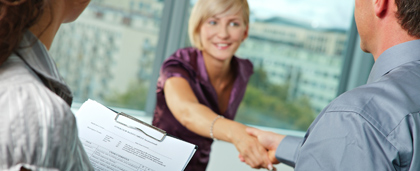 employer shaking hands with an interviewer