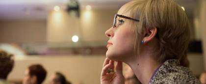 conference attendee listening to speaker
