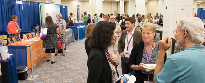 exhibitor speaking with conference attendee