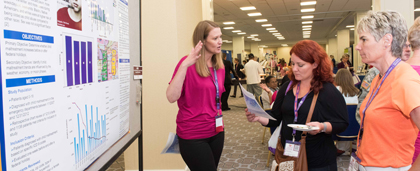 conference attendees at a poster session
