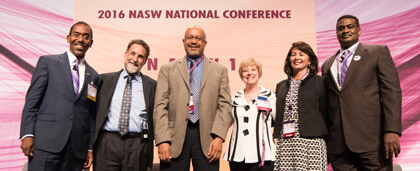 group stands on stage at 2016 NASW national conference
