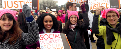 people at a rally, holding signs that say social workers for social justice