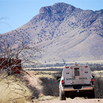 border patrol truck drives on a dirt road