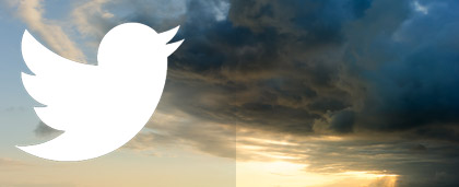 Twitter logo with clouds