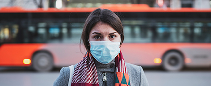 woman standing outside wearing face mask