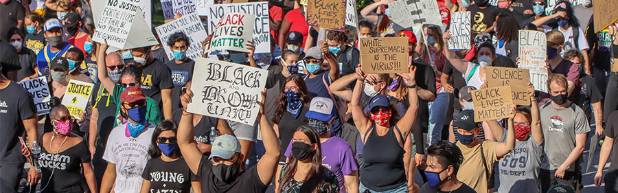 people protesting with signs: black lives matter, white supremacy is the virus. Photo credit: Chris Budnick, NASW-NC member