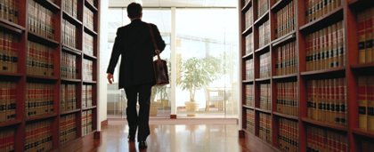 man walking through legal library